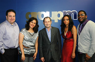 GroupMNorth America's HR Director Tim Cecere (left) and CEO Rob Norman (center) join Salwa Sayed (second left), Rahel Araya and Cory Rainford, the first GroupM Scholars.