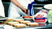 LET'S MAKE A SANDWICH: Gaga pauses to whip up lunch with Wonder Bread, Miracle Whip.