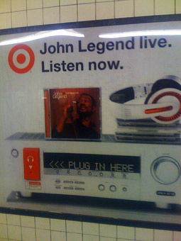 Go ahead, plug in. It's a John Legend Target subway poster.