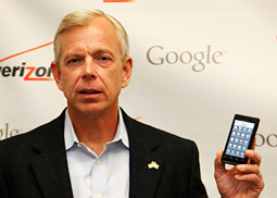 Lowell McAdam, president-CEO of Verizon Wireless, holds up the Droid at a joint announcement with Google earlier this month.
