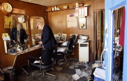 Aaron Biber's vandalized barbershop in Tottenham